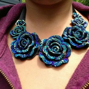 Jewelry - Blue rose multichrome ribbon statement necklace.